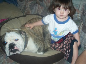 Our daughter and our Bulldog stud. Best buddies!