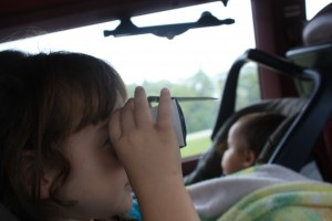 Brianna using her binoculars to search for the ellusive policeman.